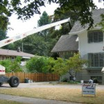 Careful Painting Boom Lift on site at a large Shaughnessy Home